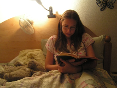 kayla-reading-in-bed.jpg